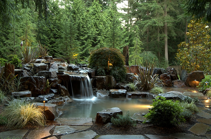 Heavy-basalt-rocks-dreamy-waterfall-and-Japanese-maple-help-shape-the-stunning-pool-retreat